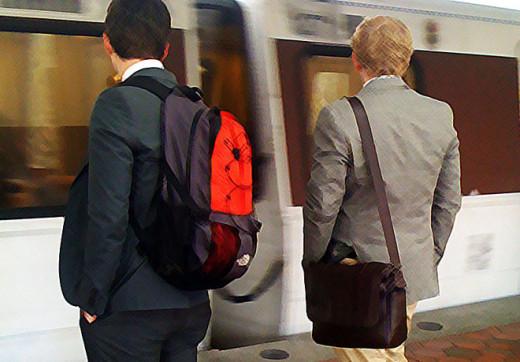 Businessmen wear backpacks in 2015.