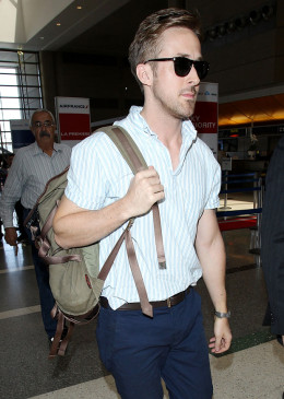 Ryan Goslin, actor, wears a backpack to a production meeting.