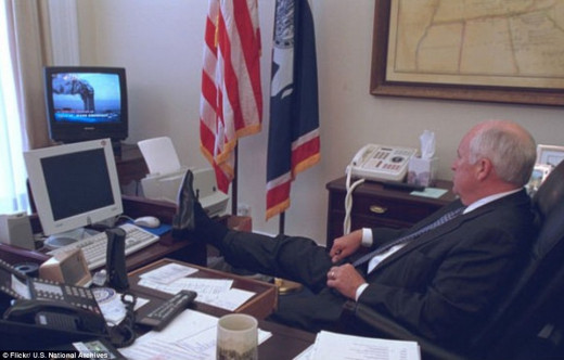 Feet on the table: then Vice-President, Cheney, watches the events unfold at the World Trade Center on live TV.