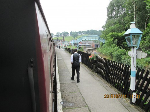 After a pleasant drive past Guisborough and onto the A171, I left the main road for Egton and Grosmont in Eskdale. At Grosmont I saw there was a train in the platform, bought a ticket and hopped aboard in time to see the guard getting active...