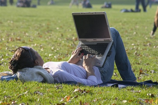 A freelancer working in a park.