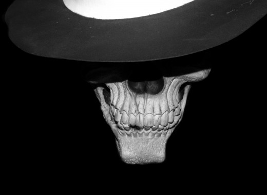 Ah, since a reader asked, this fine fellow is meant to be the Skeleton Detective, Skulduggery Pleasant. I sort of went to town in editing so you'll see a Warhol-esque gallery of this fellow below. Enjoy!