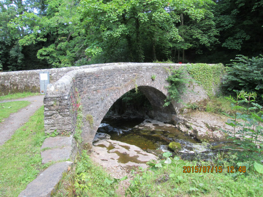 The small stone bridge spans the beck as it leaves the pool above. Downstream a rock platform is inaccessible to any but the nimblest