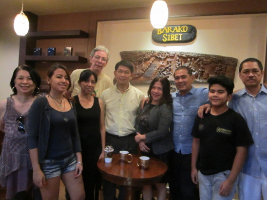 Christopher Gonzaga (center, white shirt) with business partners Menchie and Al  to his left, and friends in media to his right.