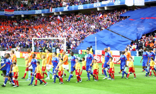 Players of France and the Netherlands walk out onto the field at Stade de Wankdorf Suisse in Berne, Switzerland during a Euro 2008 match. The Netherlands won 4-1 to book a place in the quarterfinals of the tournament.