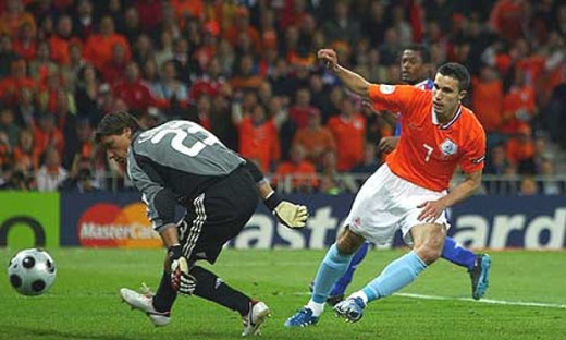 The Netherlands Robin van Persie begins to celebrate after scoring past France's Lionel Coupet. It was the second goal of the game as the Netherlands won 4-1 to clinch Group C at Euro 2008.