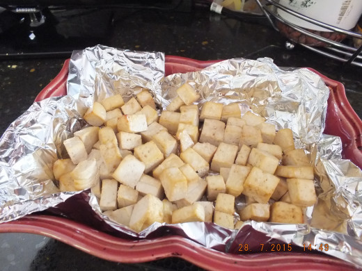 Bake the marinaded tofu in a 400 degree oven for 20 minutes. If you like you tofu chewier go about 35-40 minutes. I use the toaster oven so as not to heat up the whole kitchen.