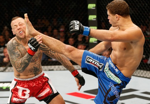 Iaquinta delivers a headkick to Ross Pearson in a fight in which he goes on to win by TKO