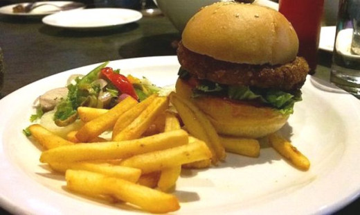 Veg Burger (with bean patty) served with crispy fries and a little salad