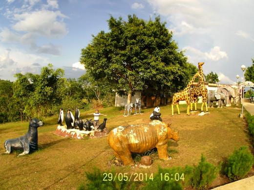 Life-size animal figures in Sagbayan Peak Kids Town.
