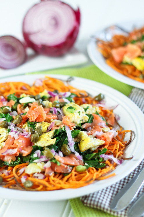 Smoked salmon breakfast scramble with collards, served on a bed of spiralized sweet potato.