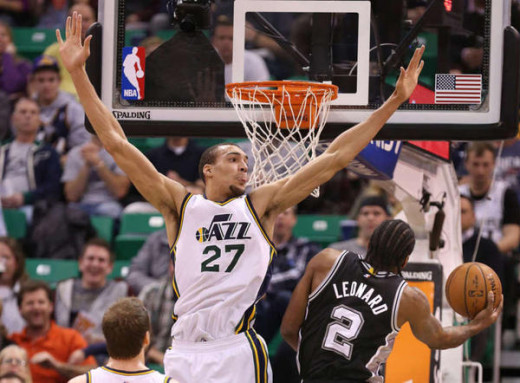 "Gobert shows off his impressive 7' 8.5"" wingspan as Spurs Forward Kawhi Leonard drives to the hoop"