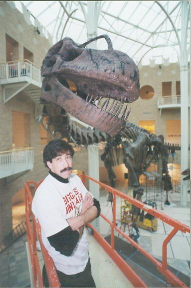 Mr. Lessem in front of Argentinosaurus mount at the Fernbank Museum of Natural History in Atlanta, Georgia, c.2001.