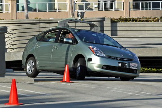 A Toyota Prius that has been modified by Google to operate as a driverless car.  This type of advanced robotic vehicle functions by sensing its environment and constantly updating its map.  It is intended to operate without human input.