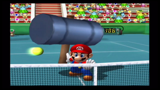Mario hitting the ball with his hammer