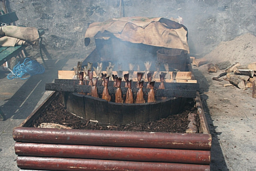 Arbroath smokies cooking in the open air.