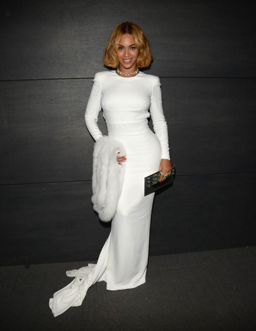 Beyoncé in a form-fitting white dress