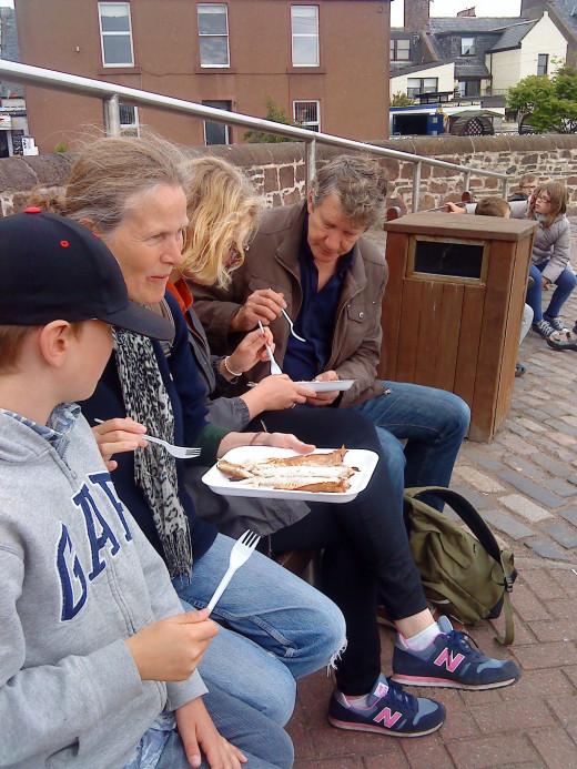 Eating smokies near Arbroath harbour.