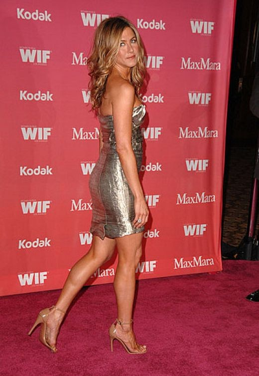 Jennifer Aniston in a low cut and short dress and high heels at the 2009 ...