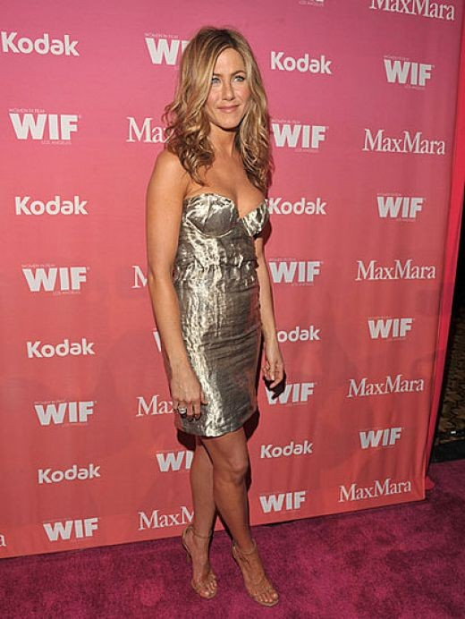 Jennifer Aniston in a low cut and short dress and high heels at the 2009 Women in Film event