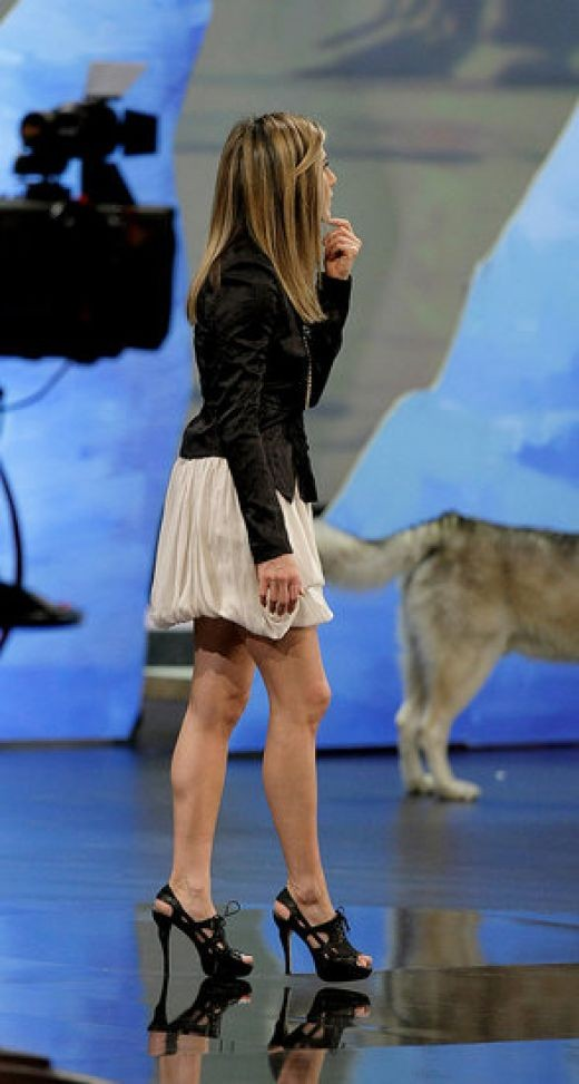 Jennifer Aniston promoting a movie in wearing towering high heels