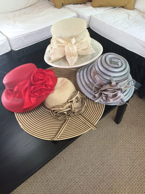 A few of my race hats. Clockwise starting at left: Big Red (Angela & William) $30, Giovannio by Emma B (Hatsational) $150, Church Cloche Derby Hat in Silver (Fanny Women's Collection) $20, Floppy wide brimmed hat in tan/brown (Jessica Simpson) $50.
