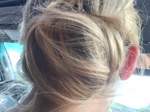 Close up of up-do done in the car on the way to the track.