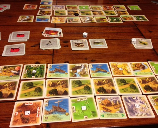 A game of Rivals of Catan further along in the process.
