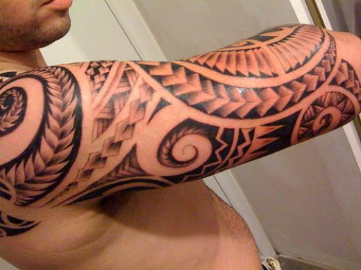 Polynesian full-arm tattoo
