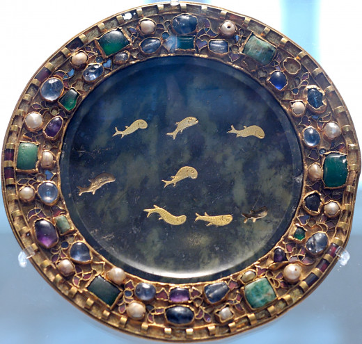 Dish of serpentine with inlaid gold fish, 1st century BCE or CE, with 9th century mounts.  Antigorite serpentine