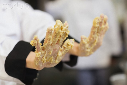 A dirty restaurant employs people who know nothing about personal hygiene--wearing plastic gloves when preparing food.