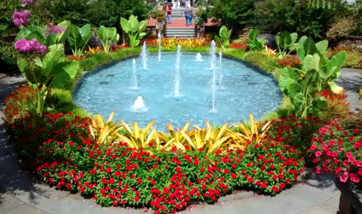 The Fountain Garden is surrounded by benches with people simply enjoying the sights and sounds.