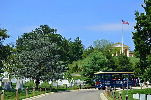 Arlington House overlooks the Kennedy gravesites. Trolley services provide transportation for anyone on a tight schedule or who prefer not to do the long walks among the monuments. © Scott Bateman
