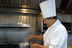 This chef is enjoying his work.
