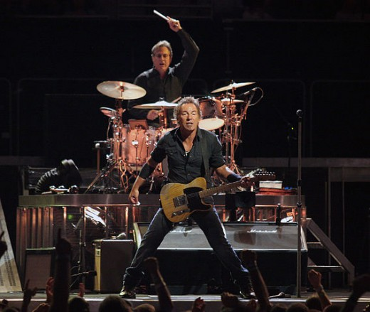 Springsteen performing with drummer Max Weinberg behind him, on the Magic Tour stop at Veterans Memorial Arena, Jacksonville, Florida, August 15, 2008. https://en.wikipedia.org/wiki/Bruce_Springsteen