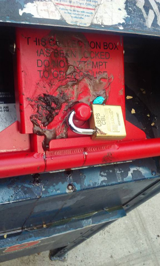 Gooey mailboxes are no fun for letter carriers.  This collection box was actually closed off, but customers still try their darndest to get some wretched unidentifiable stuff inside.
