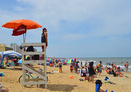 A lifeguard watches over the crowded and ever-popular Virginia Beach.
