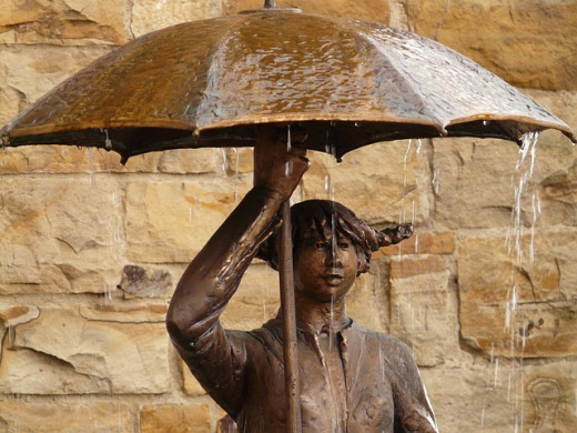 Statue of woman with umbrella.