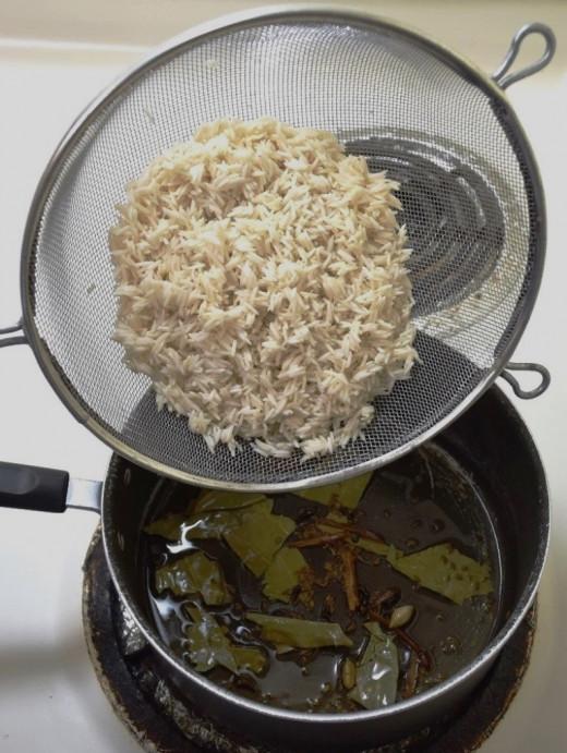 Add soaked basmathi rice.