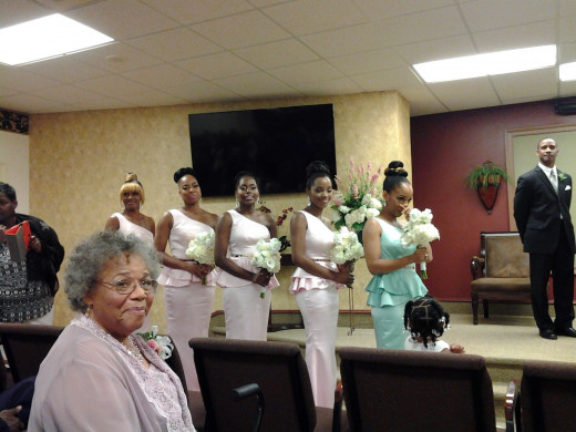 Grandmom Susie, looks on along with bridesmaids, Darlena, Sheena, Nisha, LaShae and Jaleesa.