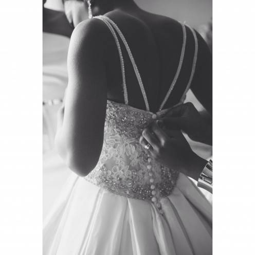 Chelsea, captures a beautiful black and white of the back of Wanisha's wedding gown.