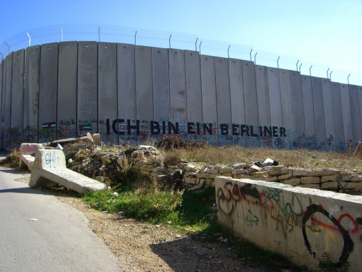 "Graffiti on the Gaza wall quotes the famous words of John F. Kennedy in 1963 - ""Ich bin ein Berliner"" (English: ""I am a Berliner"")"