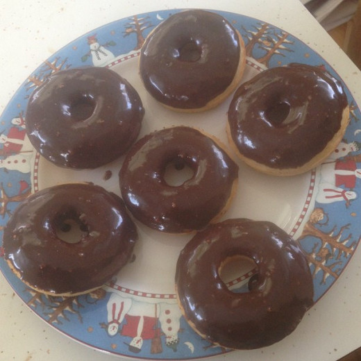"""Chocolate covered doughnnuts served as """"Spare tires"""" for the theme."""