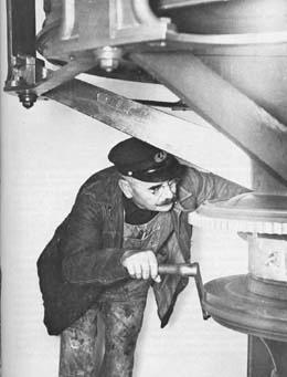 lighthouse keeper winding clockwork mechanism, ca. 1890
