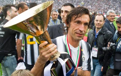 Andrea Pirlo holding the Scudetto / Serie A trophy.