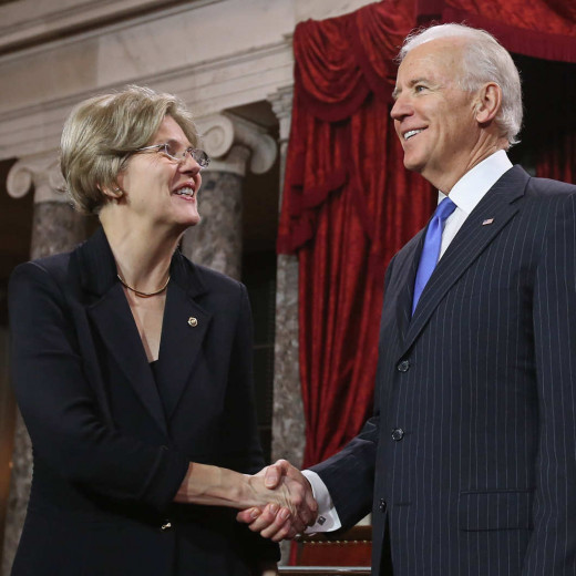 U.S. Senator Elizabeth Warren (D-MA), left, shakes hands with vice president Joe Biden, right.