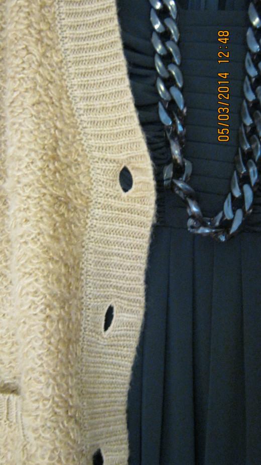 Beige cardigan over black Calvin Klein dress