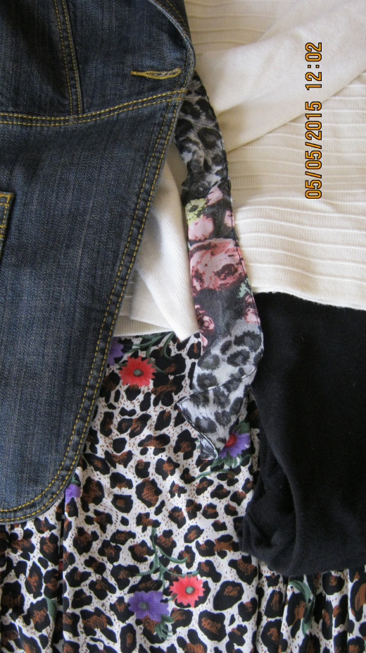 Denim jacket over white pullover and long leopard print and floral skirt