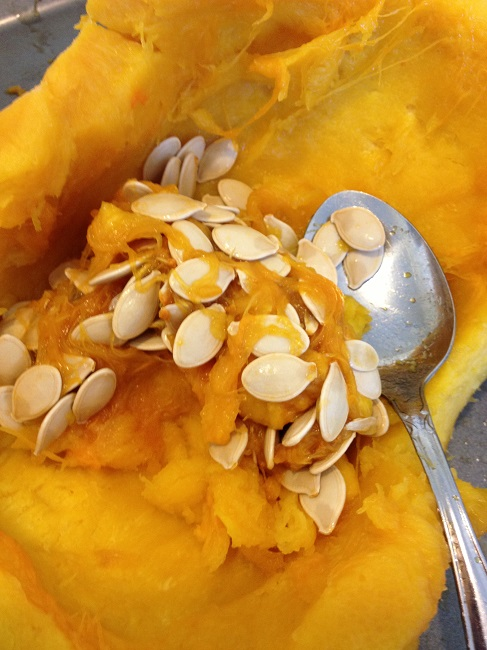 Scooping the seeds and pulp from the roasted butternut squash