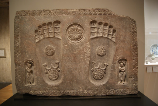 Buddha's footprints. The Buddha did not want his followers to make him into a god, so at first there were no statues of him. He was shown only through symbols, such as his footprints.